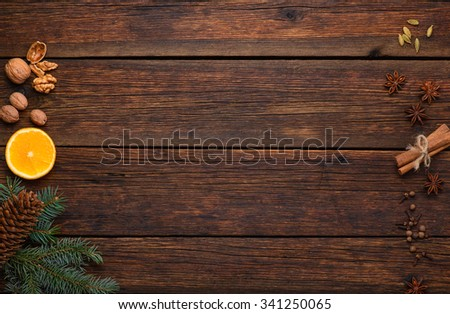 spices ingredients for glintwine on vintage wooden table background top view - stock photo