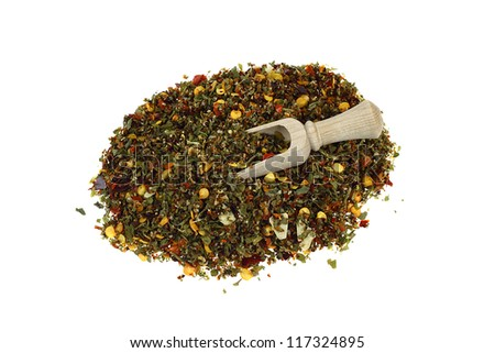 Spices mixture in a pile and scapula isolated on white - stock photo