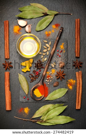 Spices on black stone board. spicy top view - stock photo