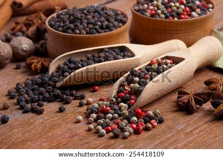 spices on spoons background dark wooden table - stock photo