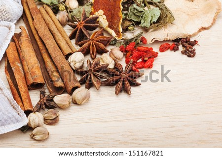 spices on wooden background - stock photo