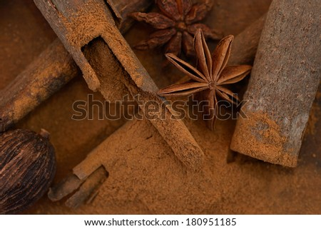 Spices on wooden table - stock photo