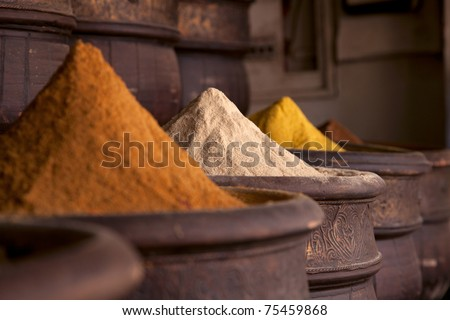 Spices pile (ginger Powder) in the  Marrakesh street shop - stock photo