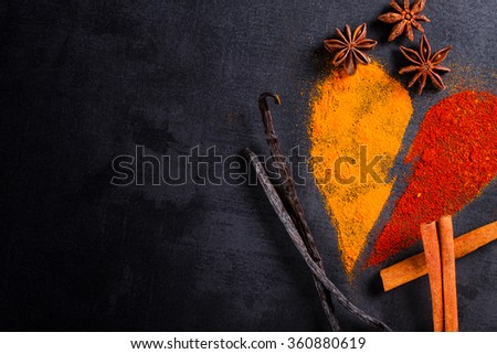 Spices piled on the pattern of broken heart with copy space. - stock photo