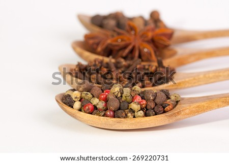 Spices. Spice in Wooden spoon. Herbs. Curry, Saffron, turmeric, cinnamon and other isolated on a white background. Pepper. Large collection of different spices and herbs isolated on white background - stock photo