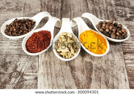 Spices. Spice in Wooden spoon. Herbs. Curry, Saffron, turmeric, cinnamon and other on a wooden rustic background. Pepper. Large collection of different spices and herbs. Salt, paprika. - stock photo