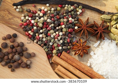 Spices. Various seasonings for cooking on wooden background - stock photo