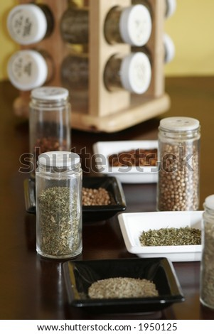 Spices with spice rack and yellow background