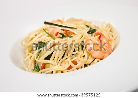 Spicy asian dish of shrimp and noodles - stock photo