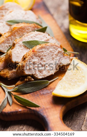 Spicy baked chicken breast with sage and lemon - stock photo