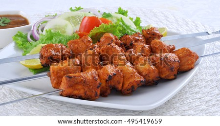 Spicy barbecued Chicken Tikka Boti on skewers