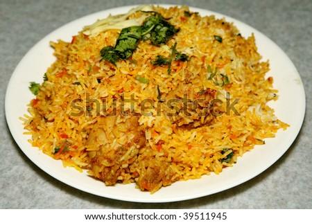 spicy basmati rice biryani in a white plate - stock photo