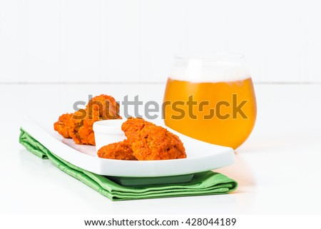 Spicy buffalo chicken wings in a less traditional more elegant setting. - stock photo