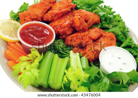 Spicy buffalo chicken wings served with hot and sour dip and crispy veggies - stock photo