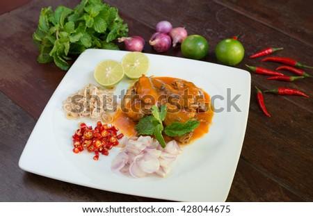 spicy canned sardine salad-food , lemongrass, chilli,lamon,onion,mint around white dish - stock photo
