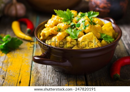 Spicy chicken and chickpeas curry - stock photo