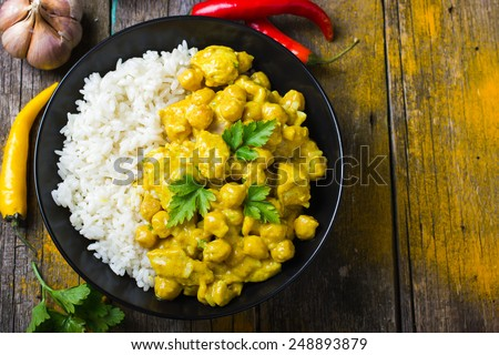 Spicy chicken and chickpeas curry and rice, top view - stock photo