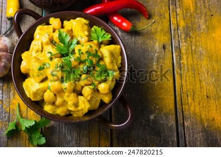 Spicy chicken and chickpeas curry, top view - stock photo