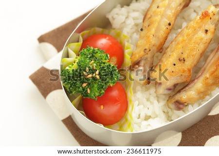 Spicy Chicken wing and rice Bento Packed lunch - stock photo