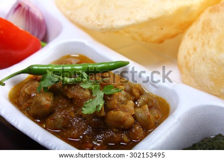 spicy chole bhature, with green chili topping indian dish - stock photo
