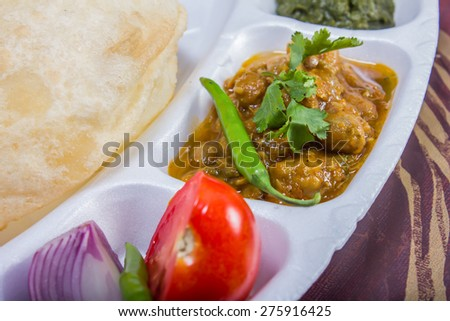 spicy chole bhautre, with green chili topping, and salad, indian dish - stock photo