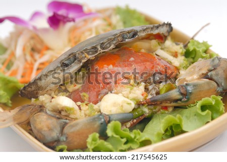 Spicy Crab,Steamed egg red crab gourmet seafood,Stirred Fried Crab with Garlic, Pepper, Curry Powder,cooked crabs with spicy sauce on white plate - stock photo
