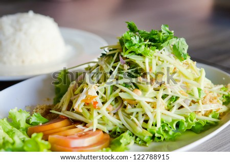 spicy crispy catfish salad with green mango and fresh vegetable served with rice