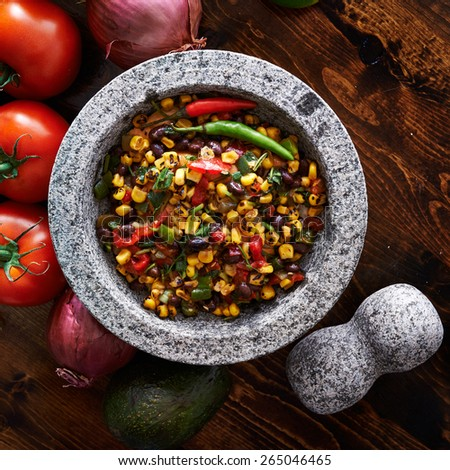 spicy fire roasted black bean and corn salsa top down photo - stock photo