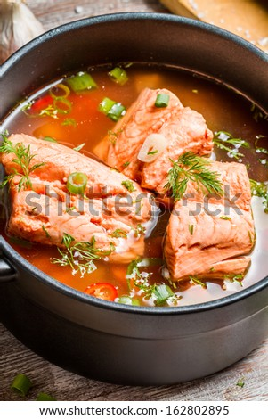 Spicy fish soup made �¢??�¢??of salmon and spiced with dill - stock photo