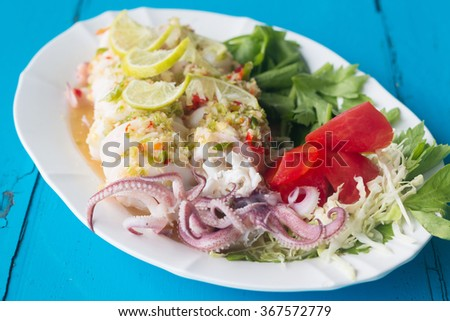 Spicy food, Steamed Squid with chili, lemon, garlic and fish sauce. - stock photo