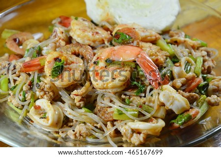 spicy glass noodle with shrimp salad on plate