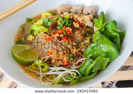 spicy grass noodle soup with pork chopped and veggies