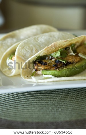 Spicy Grilled Fish Taco with Chipotle Lime Dressing on a White Corn Tortilla - stock photo