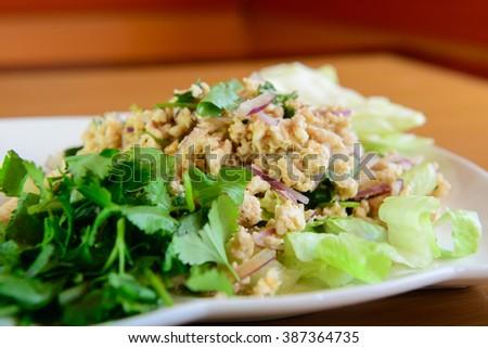 Spicy Ground Chicken Salad (Lab Gai) - stock photo