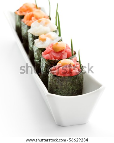 Spicy Gunkan Sushi (salmon, tuna and scallop) with Sauce and Lettuce - stock photo