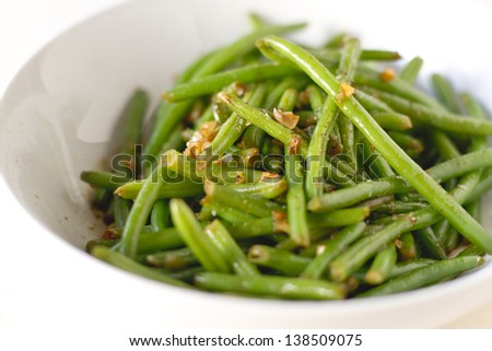 Spicy haricot vert green beans in a bowl. - stock photo