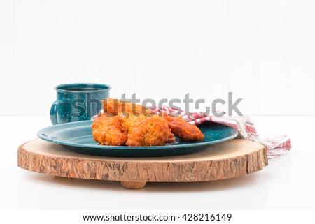 Spicy hot buffalo style chicken wings on a tin plate. - stock photo