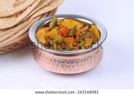 Spicy Indian vegetable curry with cauliflower, sweet potato, and carrot - stock photo