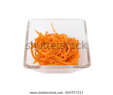 Spicy Korean carrot salad in a square glass bowl.   Isolated on a white background. - stock photo