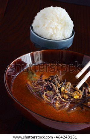 Spicy Korean soup served with glutinous rice