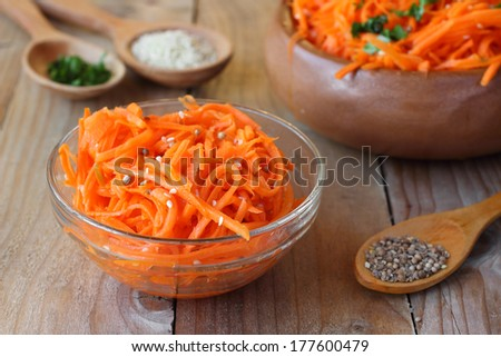 Spicy Korean-style carrot salad in a bowl with spices - stock photo