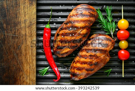 Spicy marinated grilled chicken breasts, top view - stock photo