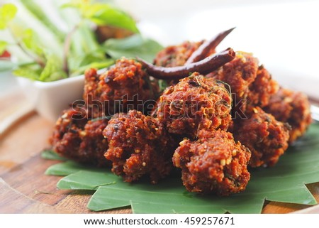 Spicy mince pork with Thai herb deep fried with dried red chili for great  and happy lunch time in Thailand - stock photo