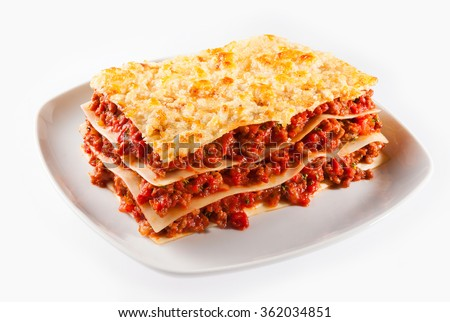 Spicy minced or ground beef lasagne with sheets of traditional Italian noodles alternating with tasty meat served on a plate isolated on white - stock photo