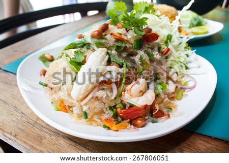 spicy noodle salad, spicy vermicelli salad (yum woon sen), thai salad famous appetizer. - stock photo