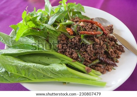 spicy pork with basil - stock photo