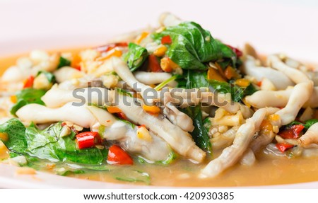 Spicy razor clam with basil food in thai style.