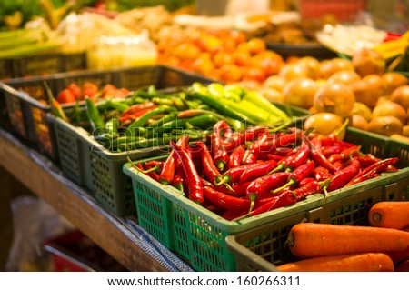 Spicy red and green peppers on city market in asia - stock photo