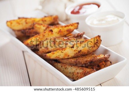 Spicy roasted potato wedges with salsa and onion dipping sauce
