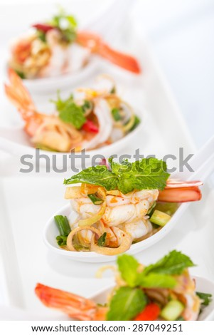 Spicy salad Shrimp with lemon grass and mint on white background